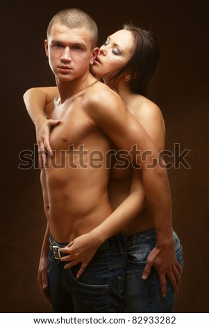 couple heterosexual topless with jeans detail studio shot - stock photo