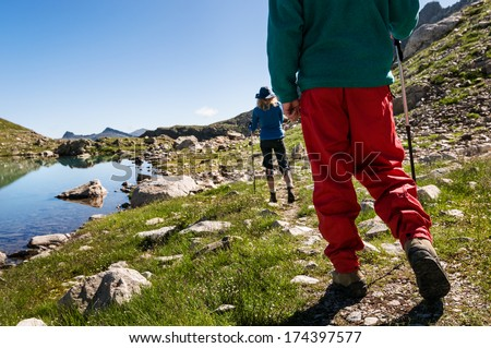 couple hiking in mountain range - stock photo