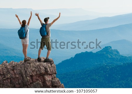 couple hiking in the mountains - stock photo