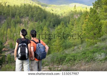 Couple hiking in the wilderness - stock photo