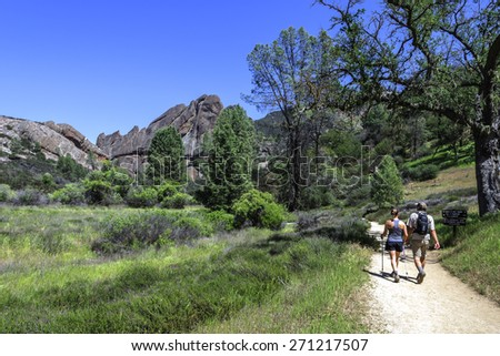 Couple hiking Pinnacles National Park in Monterey County, California, near the Salinas Valley, on the California Central Coast - stock photo