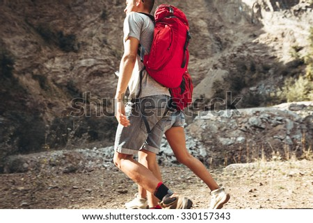Couple hiking.They got backpacks on back. - stock photo