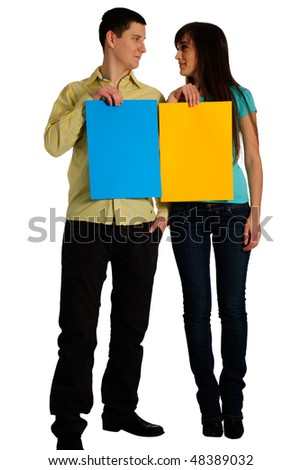Couple hold colored cards with copy space and smile. Look on each others. Isolated on white - stock photo