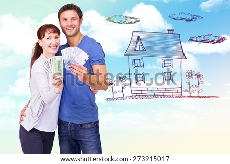 Couple holding fans of cash against blue sky - stock photo