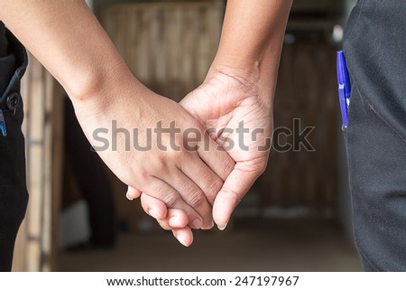 couple  holding hands in a hands of a young couple. - stock photo