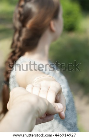 Couple holding hands on outside - stock photo