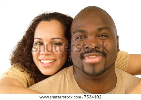 Couple hugging and smiling in a close-up portrait shot on white - stock photo