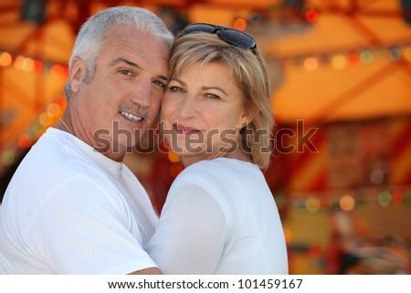 Couple hugging on holiday - stock photo