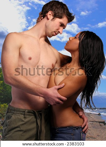 Couple Hugging on the Beach - stock photo