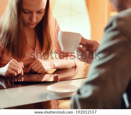 Couple ignoring each other busy with their mobile devices. - stock photo