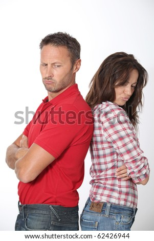 Couple in a bad mood on white background - stock photo