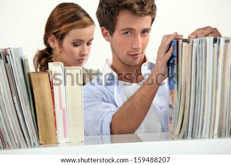 Couple in a library - stock photo