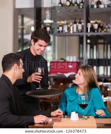 Couple in a romantic dinner at the restaurant - stock photo