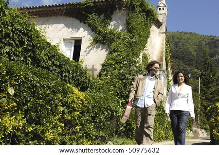 Couple in a vineyard - stock photo