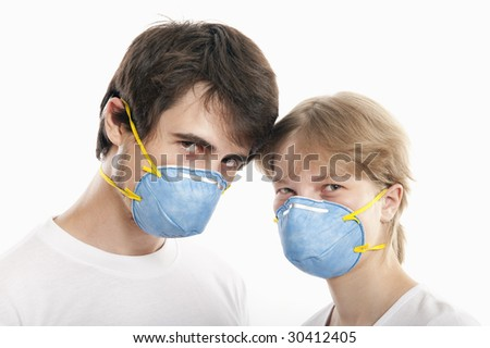 Couple  in blue face masks  with heads together  against white background - stock photo