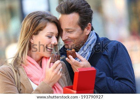 Couple in Bordeaux eating, typical pastry - stock photo