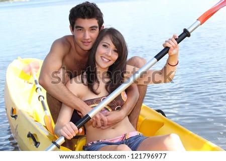 Couple in canoe - stock photo