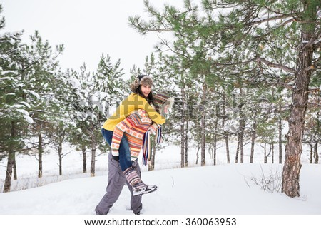 Couple in love. A woman of Asian appearance, a European man. Relations. Love. Life style. Winter snow park. Copy space. - stock photo