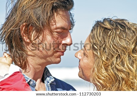 Couple in love at the beach - stock photo