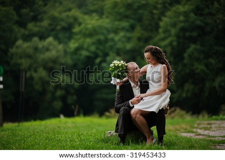 Couple in love at the dense forest - stock photo