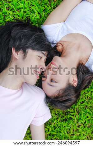 Couple in love, Closeup young asian couple laying on - stock photo