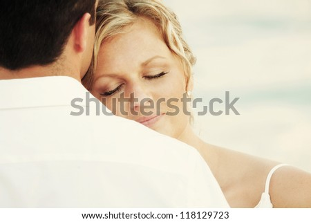 Couple in love - contented woman - stock photo