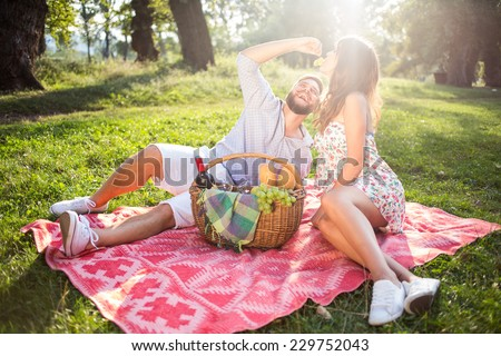 Couple in love enjoy in park on picnic. - stock photo