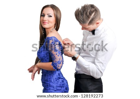 Couple in love going to the party, it helps to put on dress - stock photo