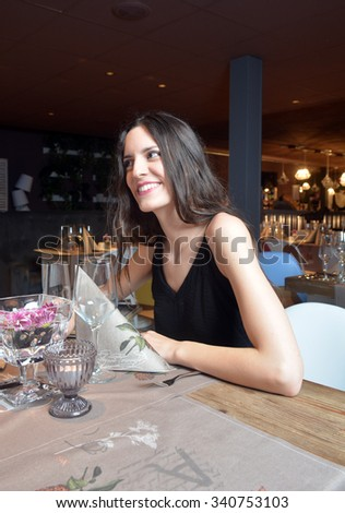 couple in love having dinner at a romantic restaurant and toasting with champagne - stock photo