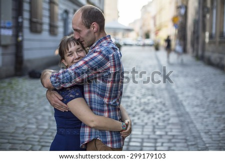 Couple in love hugging on the street. Man and woman during honeymoon.  - stock photo
