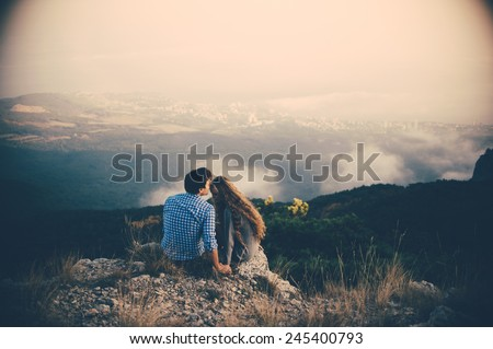 couple in love in mountains - stock photo