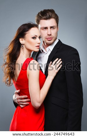 couple in love in studio, fashion, woman in red - stock photo