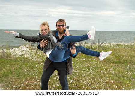 couple in love near the sea autumn. beautiful places in Europe  - stock photo