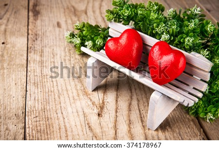 Couple in love of two heart on bench valentines day - stock photo