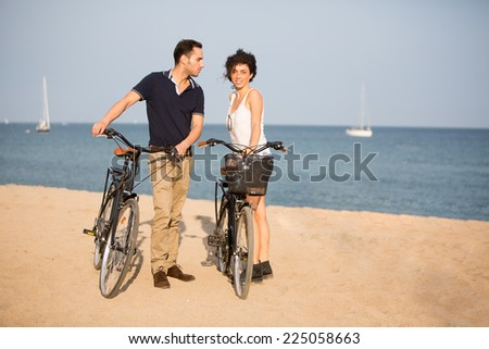 Couple in love on city beach - stock photo