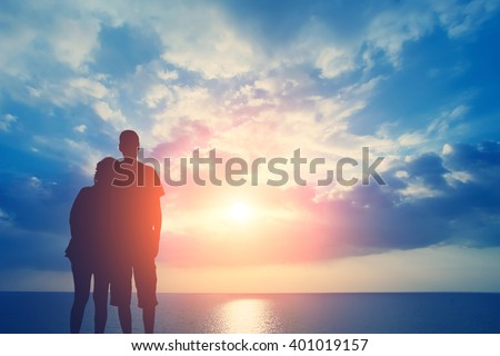 Couple in love on the background of the sea and sky with clouds - stock photo