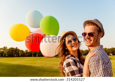 couple in love walking with balloons - stock photo
