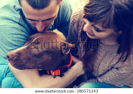 Couple in love with dog nature dog licking man - stock photo