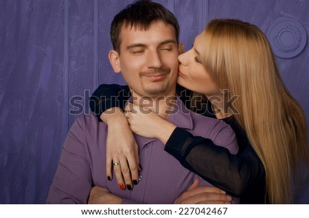 Couple in love. Woman kissing her man his cheek - stock photo
