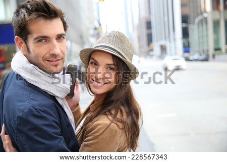 Couple in Manhattan using smartphone  - stock photo