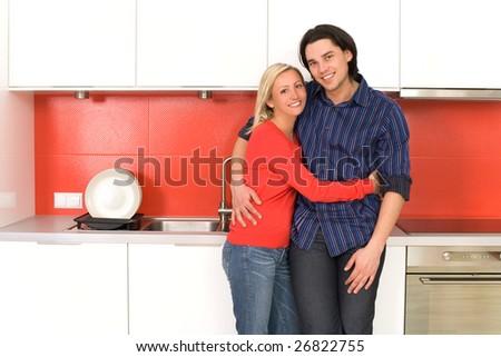 Couple in modern kitchen - stock photo