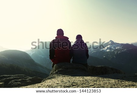 couple in mountains - stock photo