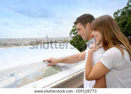 Couple in Paris looking at the city view from Montmartre - stock photo
