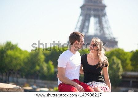 Couple in Paris with the Eiffel tower in the background - stock photo