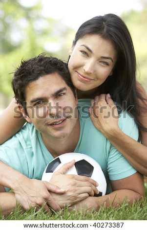 Couple In Park With Football - stock photo