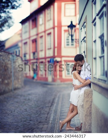 Couple in Prague, Czech Republic, Europe. Happy young couple walking outside in old town. - stock photo