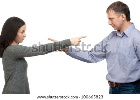 Couple in quarrel. Woman pointing at man, isolated on white background - stock photo