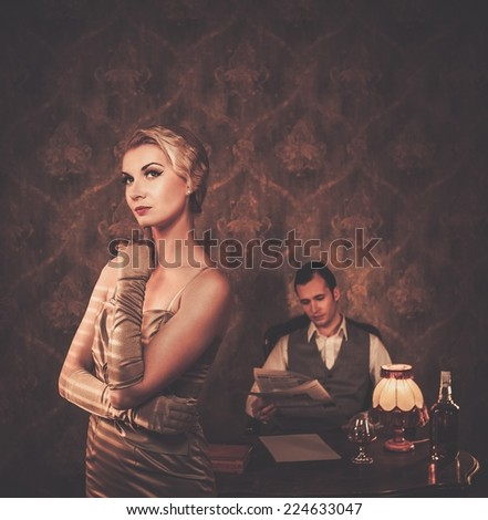 Couple in retro home  interior - stock photo