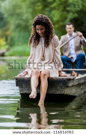 Couple in the boat - stock photo