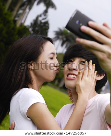 couple in the park on the grass, have a good time together - stock photo